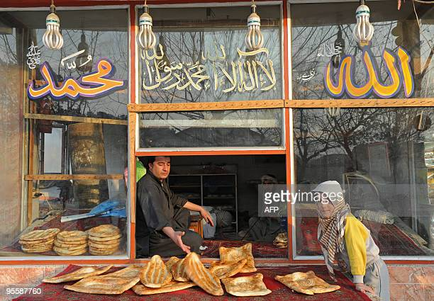 An Afghan man sells bread at a bakery in central Kabul on January 1 2010 Afghanistan's war exited 2009 on a sour note for an international community...