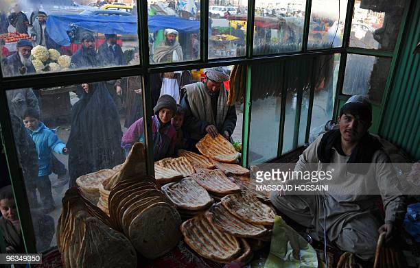 An Afghan man sells bread at a bakery in Kabul on February 1 2010 Afghanistan one of the world's poorest countries is sitting on mineral and...