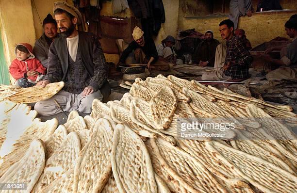 An Afghan man sells bread March 12 2003 along Mohammad Jan Khan Watt Street in Kabul Afghanistan The market along Mohammad Jan Khan Watt St is...