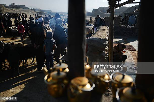 An Afghan man sits at a small tea shop in a livestock market in the outskirts of Kabul on December 28 2013 Hundreds of traders gather daily at the...