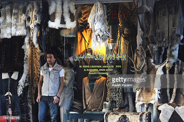An Afghan man stands outside a shop specialized in leather fur and animal skin in Chicken Street on October 17 2011 in Kabul Afghanistan Chicken...