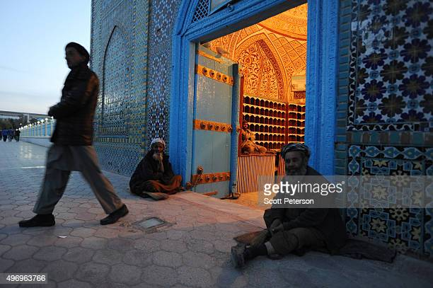 An Afghan man steps out of one door of the ancient Blue Mosque asAfghans go about daily life despite security fears of a resurgent Taliban across the...