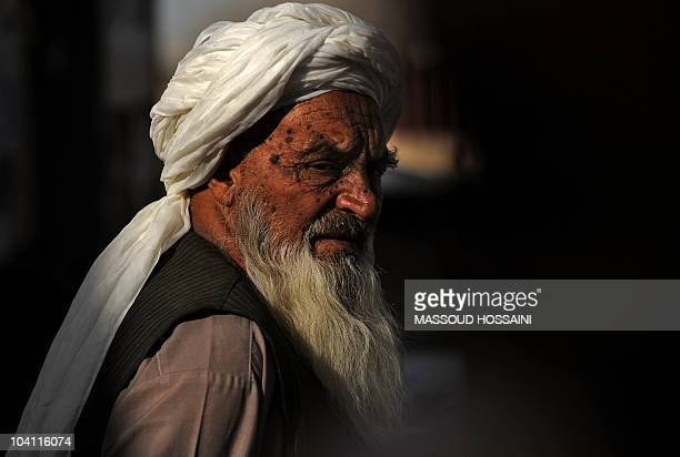 An Afghan man waits for food donations from Turkish soldiers with the International Security Assistance Force in Kabul on September 14 2010 Election...