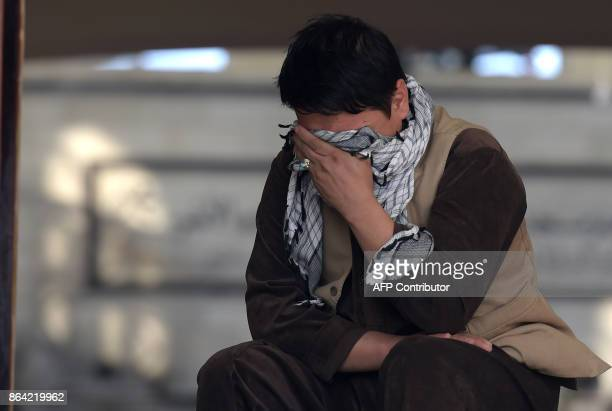 An Afghan man weeps inside the Imam Zaman Shiite mosque the day after a suicide attack during Friday evening prayers in Kabul on October 21 2017 A...