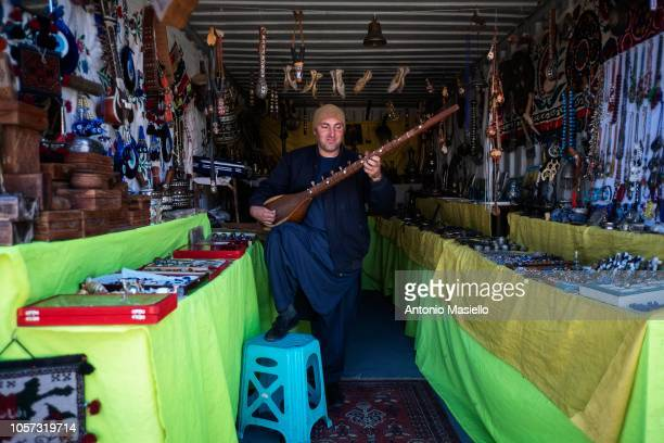An Afghan man works in a market shop inside the Camp Arena military base near Herat airport on November 04 2018 in Herat Afghanistan The Italian...