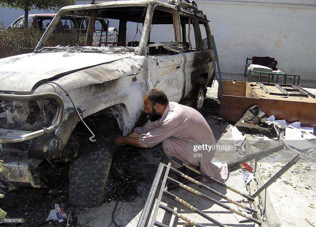 An Afghan man works on a damaged vehicle : News Photo