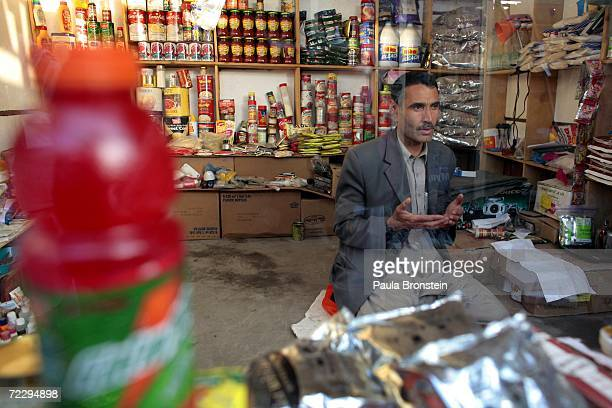 An Afghan merchant prays inside his shop at the Bush Bazaar October 29 2006 in Kabul Afghanistan The small black market named after US President...