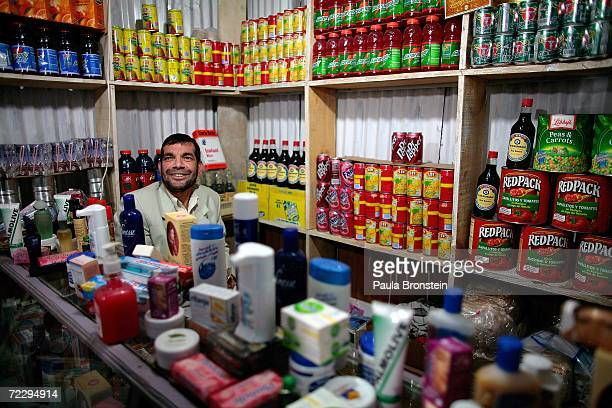 An Afghan merchant sits inside his shop at the Bush Bazaar October 29 2006 in Kabul Afghanistan The small black market named after US President...