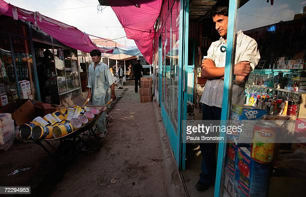 An Afghan merchant stands outside his shop waiting for business at the Bush Bazaar October 29 2006 in Kabul Afghanistan The small black market named...