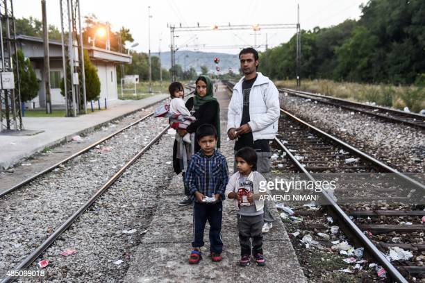 An Afghan migrant family pose in the railways near the town of Preservo on August 24 2015 Faced with what the bloc has called its worst refugee...