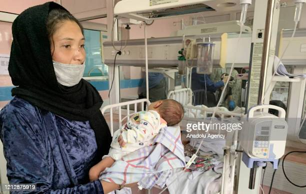 An Afghan mother feeds a newborn baby who survived recently from the gunmen attack on MSF hospital at the Ataturk Hospital in Kabul Afghanistan on...