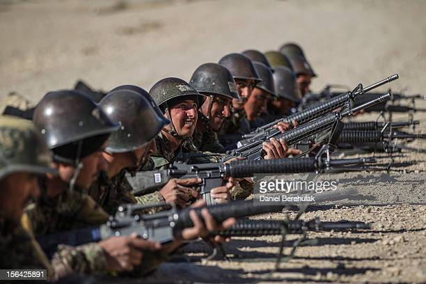 An Afghan National Army cadet looks for help from an instructor during exercises at the shooting range at the Kabul Military Training Center on...