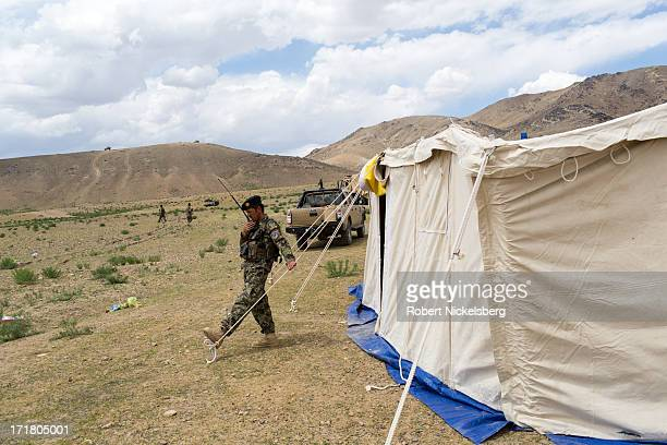 An Afghan National Army commanding officer from the 7th Kandak speaks on a radio May 6, 2013 during a joint operation setting up an Afghan Forward...