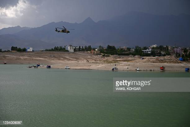 An Afghan National Army helicopter flies over the Qargha Lake on the outskirts of Kabul on July 16, 2021.