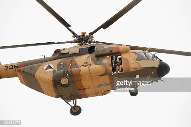 An Afghan National Army helicopter prepares to land at Forward Operating Base Maiwand an ANA base that adjoins the US Army's FOB Shank on March 27...