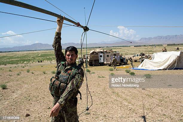 An Afghan National Army officer from the 7th Kandak sets up a radio antennae May 6, 2013 during a joint operation establishing an Afghan Forward...