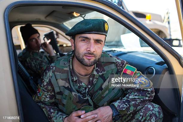 An Afghan National Army officer from the 7th Kandak sits in a pick-up truck May 6, 2013 during a joint operation with U.S. Army soldiers from the 4th...