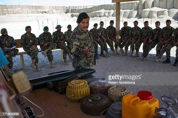 An Afghan National Army officer instructs Afghan soldiers how to recognize Improvised Explosive Devices May 8, 2013 at Forward Operating Base Shank,...