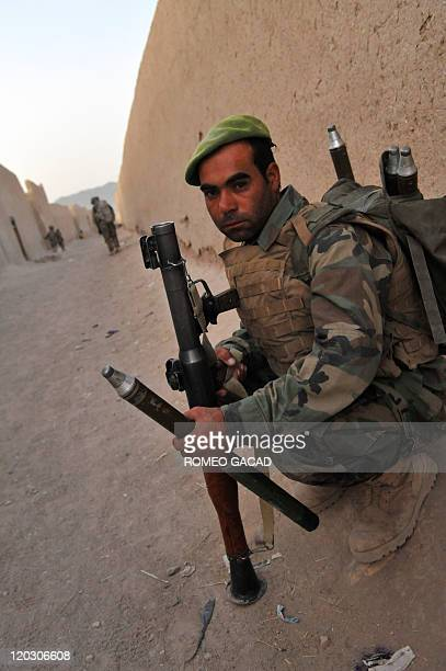 An Afghan National Army soldier armed with a rocket propelled grenade launcher looks on during a joint security patrol with the 2nd Platoon Charlie...