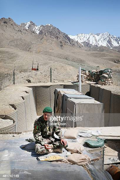 An Afghan National Army soldier eats lunch at his outpost along the KabulGardez Highway on March 31 2014 near Pule Alam Afghanistan Soldiers at the...