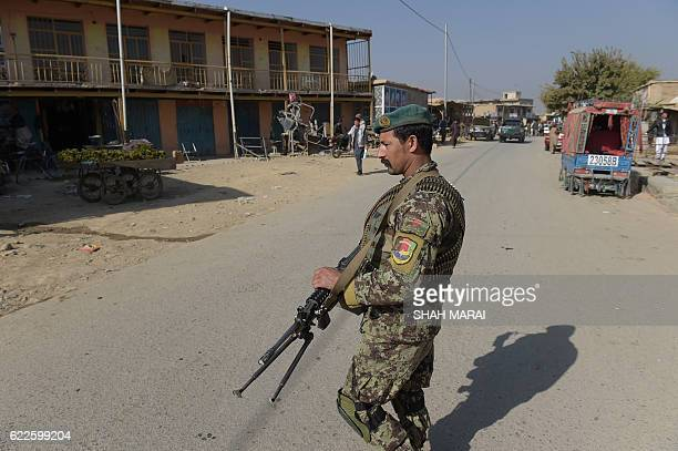 An Afghan National Army soldier keeps watch near the largest US military base in Bagram, 50km north of Kabul on November 12, 2016. Four people were...