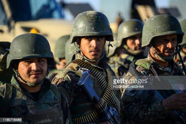 An Afghan National Army soldier looks on as he takes part in a military exercise at a training centre in Herat on December 29, 2019.