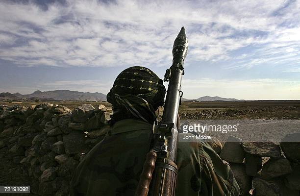 An Afghan National Army soldier looks towards the Pakistani border only 200 meters away October 17, 2006 near Camp Tillman in the Paktika province of...