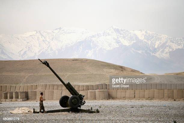 An Afghan National Army soldier performs maintenance on a Russianmade artillery gun at Forward Operating Base Maiwand an ANA base that adjoins the US...