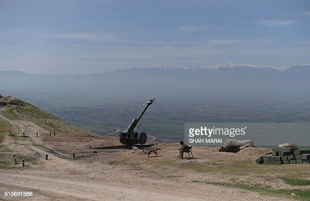 An Afghan National Army soldier sits down in DandeGhori district in Baghlan province on March 15 following weeks of heavy battles to recapture the...