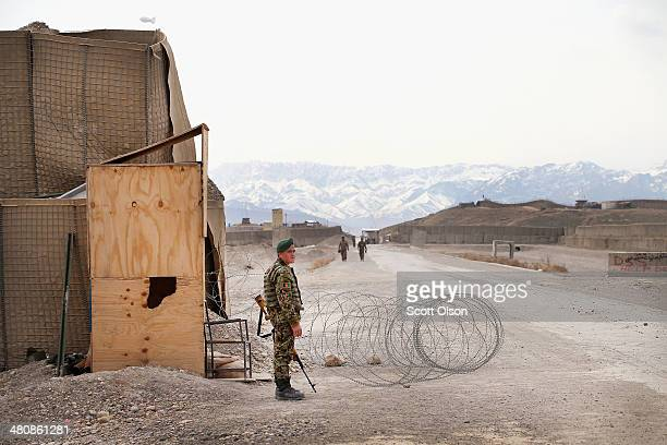 An Afghan National Army soldier stands guard at a checkpoint on Forward Operating Base Maiwand an ANA base that adjoins the US Army's FOB Shank on...