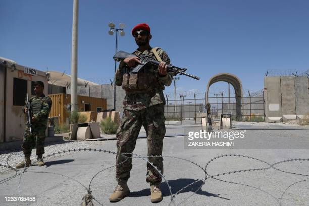 An Afghan National Army soldier stands guard at Bagram Air Base, after all US and NATO troops left, some 70 Km north of Kabul on July 2, 2021.