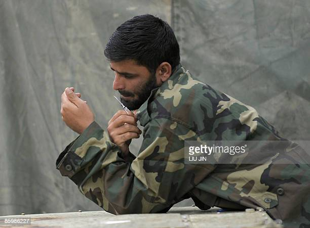 An Afghan National Army soldier trims his beard at ISAF's Camp Bostick in Naray, in the eastern Kunar province on April 15, 2009. Afghanistan warned...