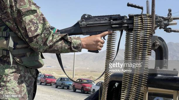 An Afghan National Army stands guard at a checkpoint on the road near to the Bagram airfield in Kabul, Afghanistan, July 03, 2021. After nearly 20...