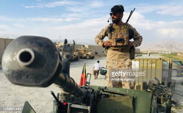 An Afghan National Army stands on a Humvee tank who keeps watch after the US forces left Bagram airfield in the north of Kabul, Afghanistan, on July...