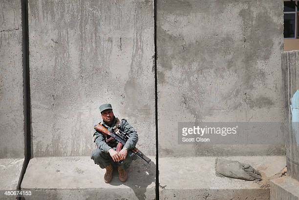 An Afghan National Police officer stands guard on the grounds of the provinial office complex which houses the office of Haji Niyaz Mohammad Amirii...