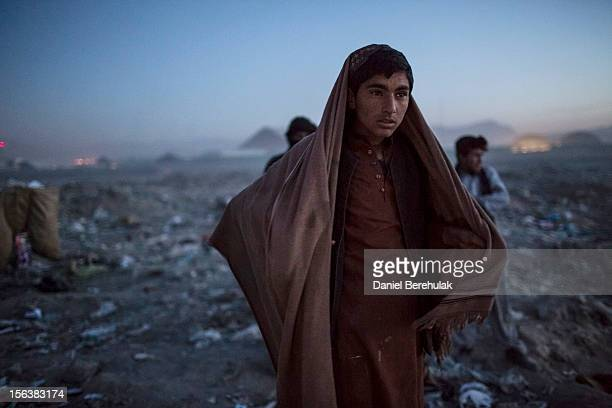 An Afghan Pashtun boy who said he was forced from the troubled province of Baglan due to threats from the Taliban looks on as he winds up for the day...