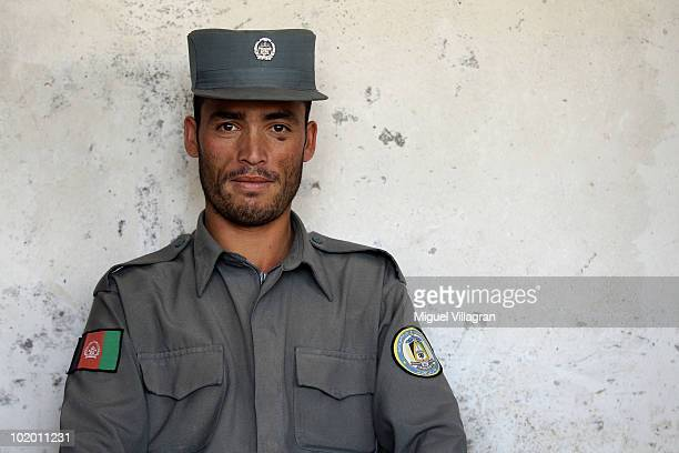 An Afghan police man looks on at the local Police Headquarter on June 12 2010 in Taloqan Afghanistan Germany has more than 4500 military forces in...
