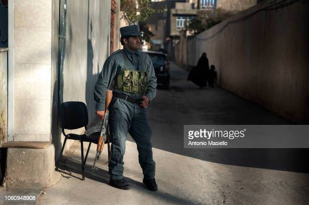 An Afghan policeman checks the road of the city centre of Herat on November 13 2018 in Herat Afghanistan The support to the Afghan population is one...