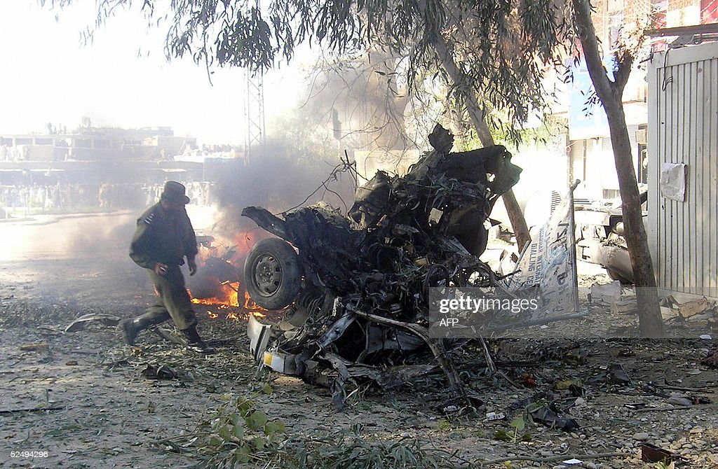 An Afghan policeman inspects the wreckag : News Photo