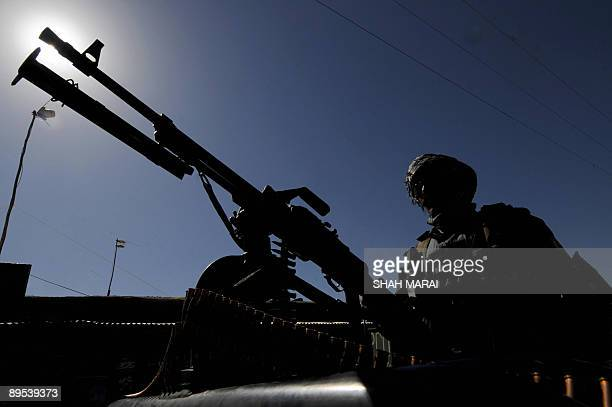 An Afghan policeman keeps watch in Kaihan valley in central Afghanistan on July 31 2009 Karzai is due to visit the valley on August 1 Afghans go to...