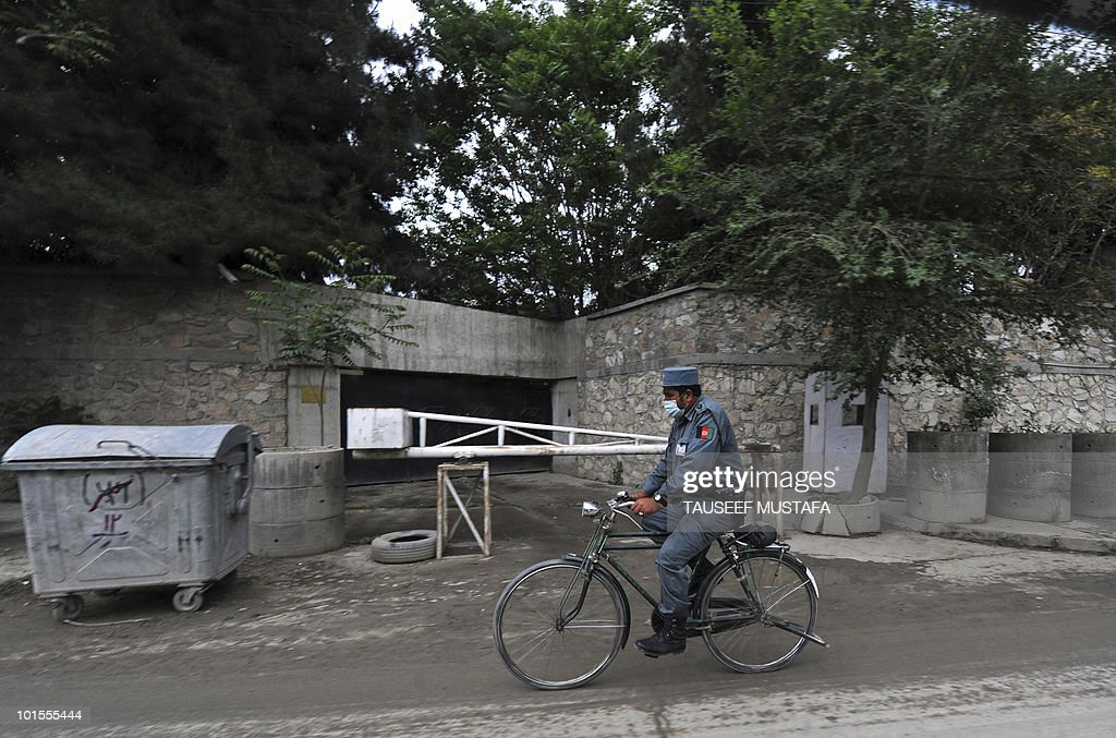 An Afghan policeman rides a bicycle in Kabul on May 1, 2010. The Afghan government on April 30 accused foreign forces of killing two women and a girl, the latest in a long list of civilians mistakenly killed by US-led troops fighting the Taliban. The interior ministry said the victims were travelling on a highway in southern Afghanistan, a flashpoint in a nearly nine-year war, when foreign troops opened fire, killing three of the five civilians in the car. AFP PHOTO/Tauseef MUSTAFA