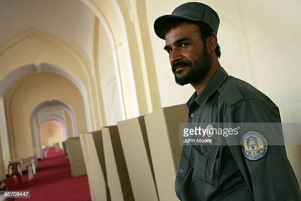 An Afghan policeman stands guard at a polling station September 17 2005 in Kabul Afghanistan Afghans will go to the polls on September 18th in the...