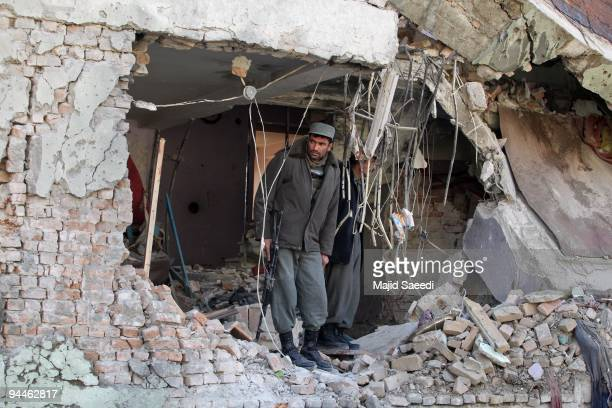 An Afghan policemen stands guard at the site of a suicide attack near a guest house on December 15 2009 in Kabul Afghanistan A suicide attack near a...