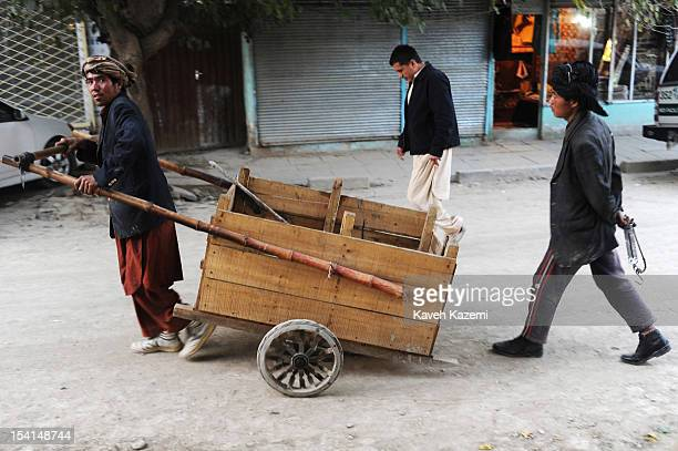 An Afghan porter pulls a wooden push cart in Chicken Street on October 17 2011 in Kabul Afghanistan Chicken Street has been a focus for Afghanistan's...