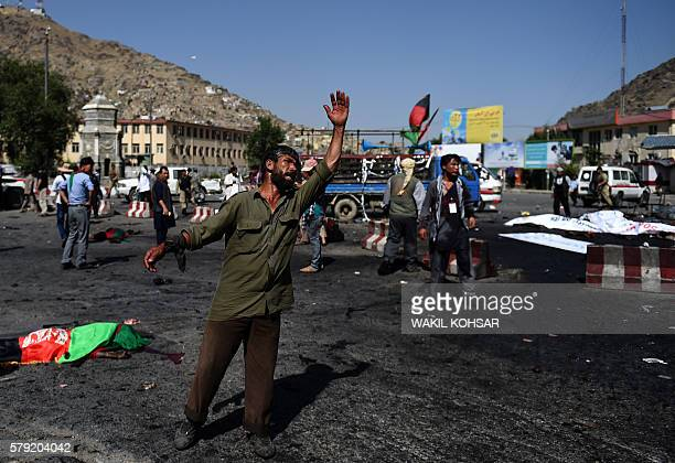 TOPSHOT An Afghan protester scream near the scene of a suicide attack that targeted crowds of minority Shiite Hazaras during a demonstration at the...