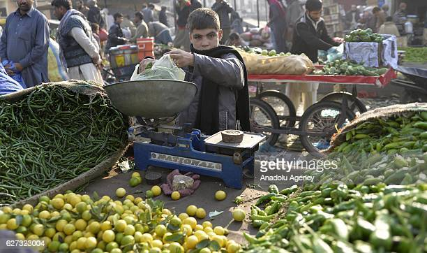 An Afghan refugee boy sells vegetable and fruits at a market in Islamabad Pakistan on December 3 as UNHCR halted the voluntary repatriations of...