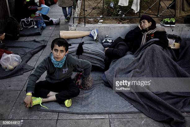 An Afghan refugee child at Victoria square after his arrival with his family at Piraeus port Athens February 22 2016