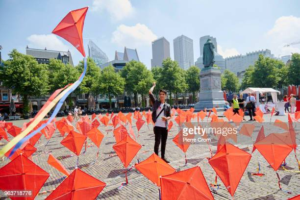 An Afghan refugee flies a kite as human rights group Amnesty International hand over a petition signed by more the 68000 people to the Dutch...