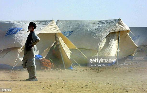 An Afghan refugee looks out from the UNHCR temporary staging area November 1, 2001 at the Afghan borderi n Chaman, Pakistan.