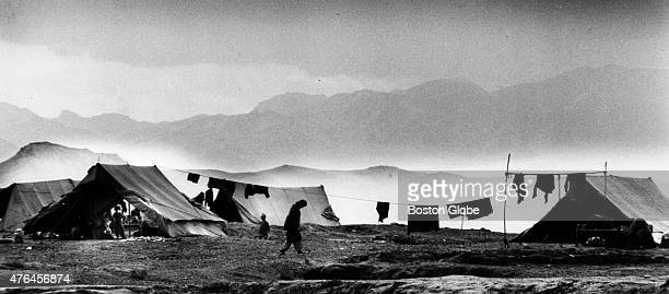An Afghan refugee walks past a tented area of the newly arrived and unregistered refugees at Kacha Gari refugee camp near Peshawar Pakistan 1987 In...